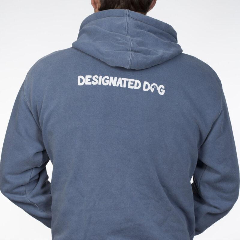 Back of man wearing denim blue Designate Dog hoodie.