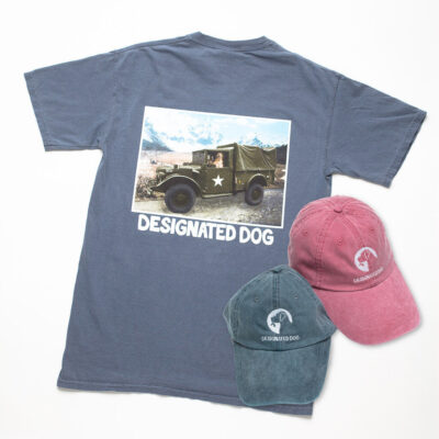 Hat ad tee with dog driving truck.