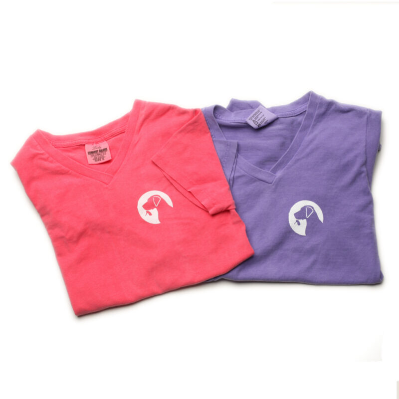 Violet and pink Ladies V-neck tees laying flat.